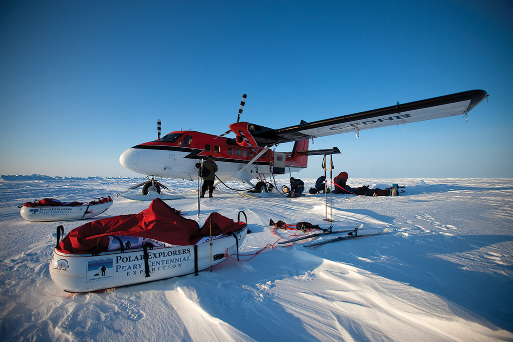 On March 25, 2009, the twin otter lands on the sea ice at 85 degrees latitude north in minus 42F degrees. Sebastian and Keith are off towing 200lbs each.